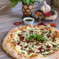 PIZZA TOMATE SECO Y PESTO KARU A LA PIEDRA
